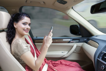 Indian woman sitting in the car