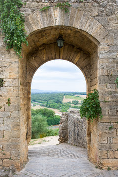 Medieval Doorway Leading to Tuscan Countryside in Italy