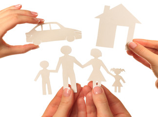 Hand holding a paper home, car, family on white background