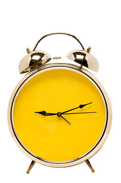 Bright yellow alarm clock with blank face.