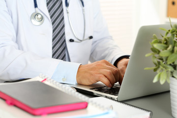 Medicine doctor hand press key on laptop computer