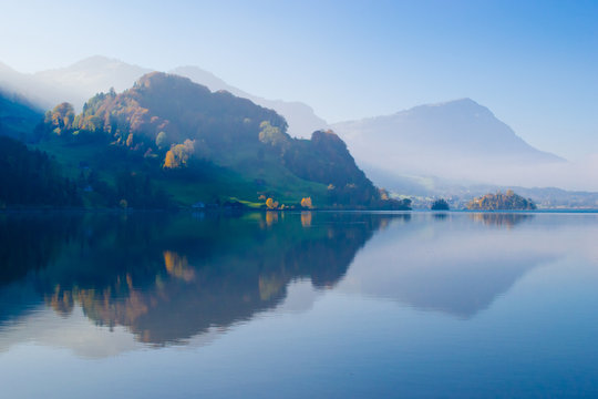 Canton Schwyz. Autumn. Reflections in calm water of the lake.