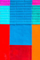 Vibrant colorful painted cement and brick wall