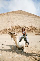 woman camel and pyramid