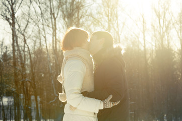 Couple kissing on sunlight backgroung in park