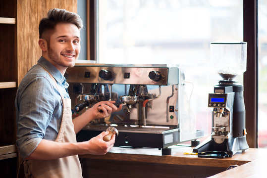 Pleasant barista working in the cafe