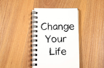 Change your life write on notebook