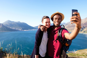 Loving young couple on holiday taking selfie