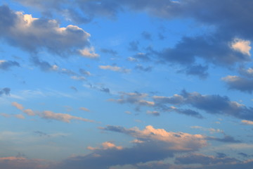Blue, beautiful sky with  orange, grey clouds