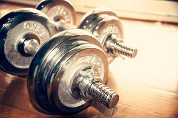 Close up silver dumbbell on floor (retro style)