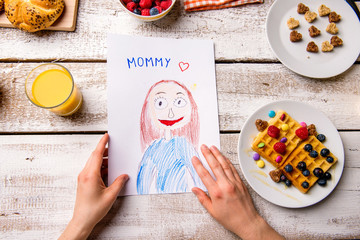 Childs drawing of her mom. Mothers day. Breakfast meal.