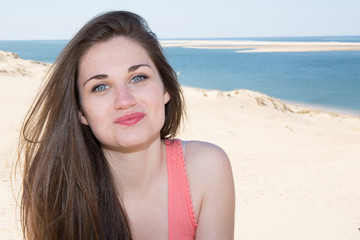 Portrait of a beautiful young brunette woman on a sunny day in the summer on the beach