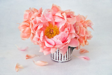 Beautiful bouquet of flowers.Floral composition with a pink peonies in a vase on the table.