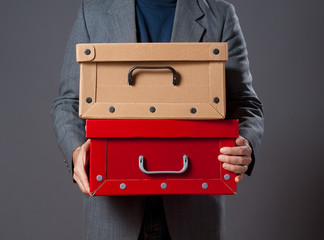 Man holding boxes.