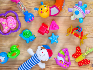 top view or flat lay on colorful toys on light wooden background