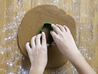 close-up shot of human hand preparing cookies.