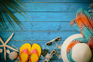 coconut leafhat,sandal,sunglasses and starfish on blue wooden background,summer concept