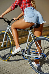 Sexy hot woman back on a sport fixed gear bike
