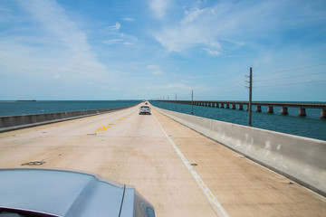 Beautiful endless road from Miami to Key West driving Ford Mustang