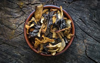 Dried mushroom on wood background