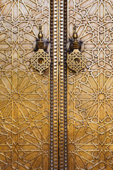 Morocco. The Royal Palace of Fez (Dar el Makhzen). Door details with a giant brass knockers