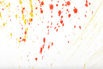 Red and yellow gouache splashes on white background.