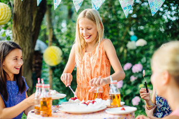 Girls having fun at summer garden party