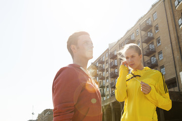 Runners standing by building block, Wapping, London