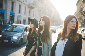 Three young women strolling in city