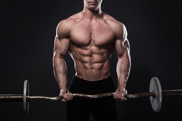 Young bodybuilder with barbell