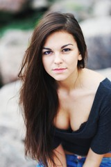portrait of a beautiful girl with long hair in a black shirt