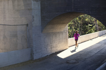 Jogger running on bridge, Arroyo Seco Park, Pasadena, California, USA