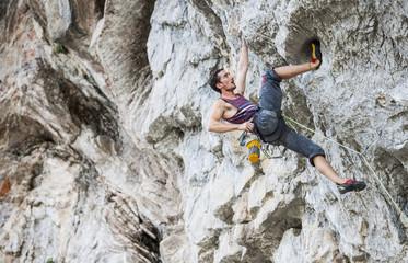 Male climber at Riverside crag in Yangshuo, Guangxi Zhuang, China