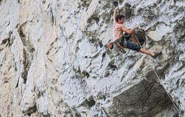 Male climber at Riverside crag, Yangshuo, Guangxi Zhuang, China