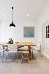 Modern scandinavian styled interior dining room with pendant lig