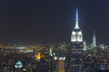 High angle cityscape of midtown Manhattan and Empire State building at night, New York, USA