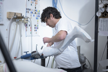 Worker preparing mould for orthopaedic support in factory