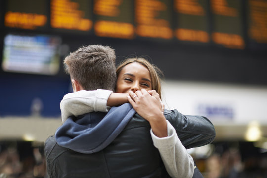 Couple hugging at railway station