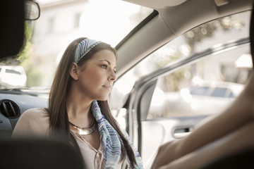 Young woman, sitting, relaxing in car