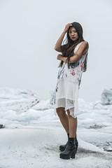 Fashion shot of woman at ice lagoon