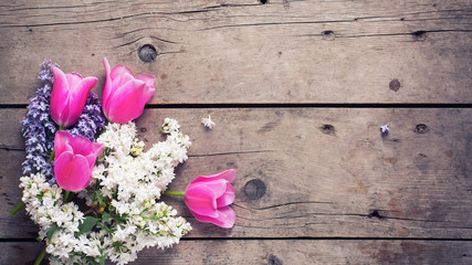 Background with fresh aromatic lilac  and pink tulips flowers