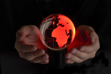 Red Crystal Globe in hand