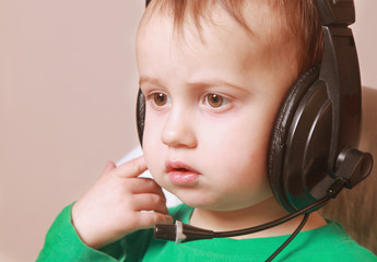 Portrait of baby support phone operator in headset on light  bac