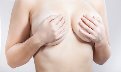 Cropped photo of a young woman's breast