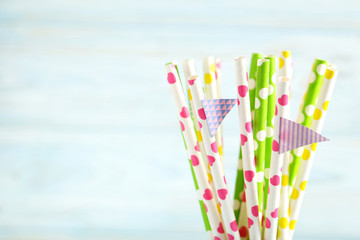 Drink straws on a blue wooden background