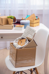 Cardboard boxes with things for relocation in room interior