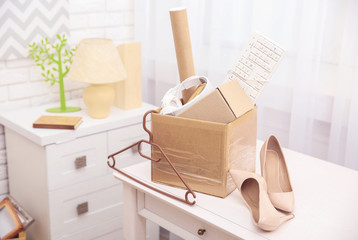 Cardboard boxes with things for relocation on light table