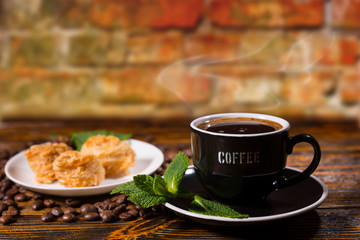 Cup of Black Coffee with Gourmet Pastries and Mint