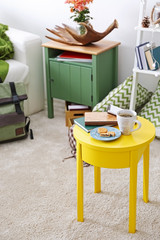 Interior of living room with yellow table