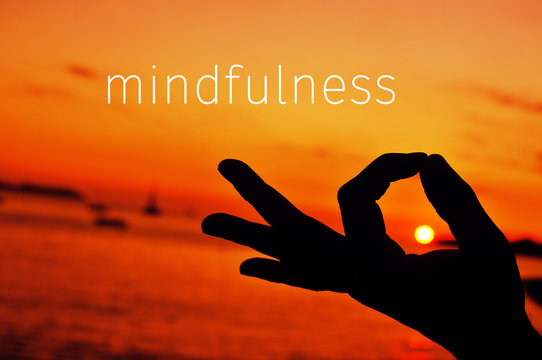 text mindfulness and hand in gyan mudra at sunset